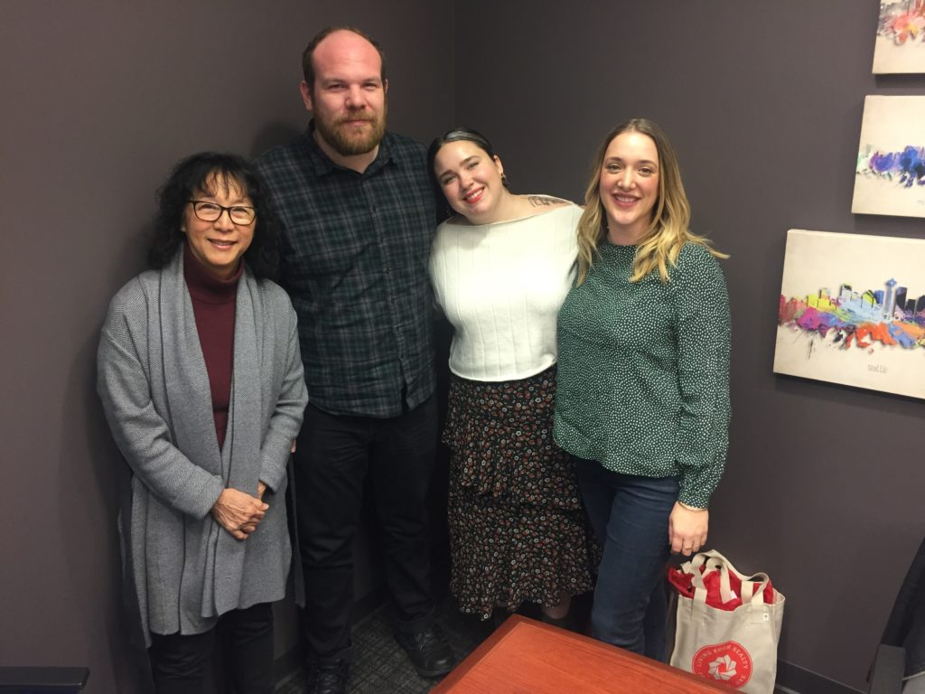 First time buyers, Catie and Greg, with their agent, Mel Marzahl, and mortgage broker