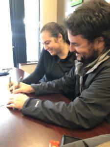 Buyers signing paperwork