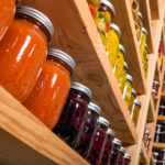 colorful canning jars on shelves